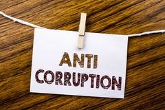 Handwriting Announcement text showing Anti Corruption. Business concept for Bribery Corrupt Text written on sticky note paper on t. Handwriting Announcement text Stock Photos