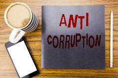 Handwriting Announcement text showing Anti Corruption. Business concept for Bribery Corrupt Text Written on notepad note paper, wo. Oden wood background coffee Stock Images