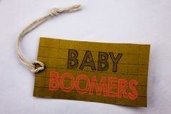 Handwriting Announcement text showing Baby Boomers. Business concept for online sale Demographic Generation written on price tag p. Aper on white vintage Royalty Free Stock Image