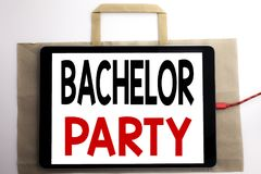 Handwriting Announcement text showing Bachelor Party. Business concept for Stag Fun Celebrate Written on shopping bag and tablet w royalty free stock photos