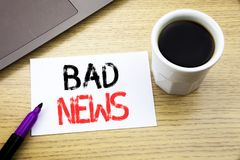 Handwriting Announcement text showing Bad News. Business concept for Failure Media Newspaper written on notebook book on the woode. Handwriting Announcement text Stock Image