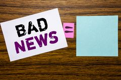 Handwriting Announcement text showing Bad News. Business concept for Failure Media Newspaper written on sticky note paper on woode. Handwriting Announcement text Royalty Free Stock Photo