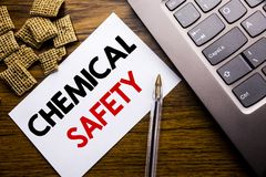 Handwriting Announcement text showing Chemical Safety. Business concept for Hazard Health At Work written on sticky note paper on. Wooden background next to the Stock Image