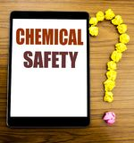 Handwriting Announcement text showing Chemical Safety. Business concept for Hazard Health At Work Written on tablet with wooden ba. Handwriting Announcement text royalty free stock image