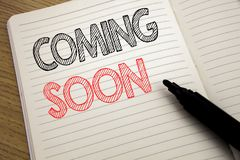 Handwriting Announcement text showing Coming Soon. Business concept for Under Construction written on notebook with copy space on royalty free stock images