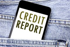 Handwriting Announcement text showing Credit Report. Business concept for Finance Score Check Written phone mobile phone, cellphon. E placed in man front jeans Royalty Free Stock Photos