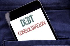 Handwriting Announcement text showing Debt Consolidation. Business concept for Money Loan Credit Written phone mobile phone, cellp. Hone placed in man front Royalty Free Stock Image