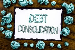 Handwriting Announcement text showing Debt Consolidation. Business concept for Money Loan Credit Written on sticky note paper, woo. Den background folded blue Royalty Free Stock Image