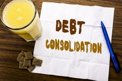 Handwriting Announcement text showing Debt Consolidation. Business concept for Money Loan Credit written on tissue paper on the wo. Handwriting Announcement text Royalty Free Stock Photography