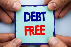 Handwriting Announcement text showing Debt Free. Business photo showcasing Credit Money Financial Sign Freedom From Loan Mortage w. Ritten Sticky Note Paper Stock Image