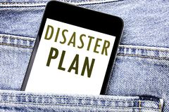 Handwriting Announcement text showing Disaster Plan. Business concept for Emergency Recovery Written phone mobile phone, cellphone. Placed in man front jeans Stock Images