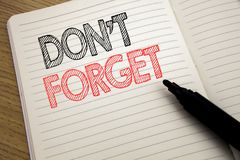 Handwriting Announcement text showing Do Not Forget. Business concept for Don t memory Remider written on notebook with copy space. Handwriting Announcement text Royalty Free Stock Photography