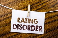Handwriting Announcement text showing Eating Disorder. Business concept for Medical Problem written on sticky note paper on the wo royalty free stock photography