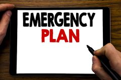 Handwriting Announcement text showing Emergency Plan. Business concept for Disaster Protection Written on tablet laptop, wooden ba stock photos