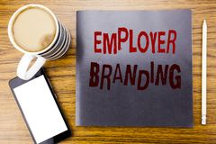 Handwriting Announcement text showing Employer Branding. Business concept for Brand Building Written on notepad note paper, wooden. Wood background coffee pen royalty free stock photo
