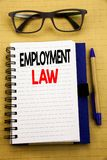 Handwriting Announcement text showing Employment Law. Business concept for Employee Legal Justice Written on tablet laptop, wooden. Handwriting Announcement text Stock Photography