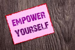 Handwriting Announcement text showing Empower Yourself. Conceptual photo Positive Motivation Advice For Personal Development writt. En Pink Sticky Note Paper the Stock Photos