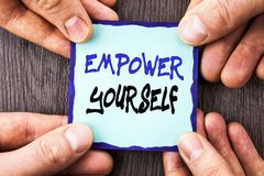Handwriting Announcement text showing Empower Yourself. Conceptual photo Positive Motivation Advice For Personal Development writt. En Sticky Note Paper Holding Stock Photos