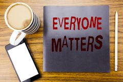 Handwriting Announcement text showing Everyone Matters. Business concept for Equality Respect Written on notepad note paper, woode. N wood background coffee pen Stock Photos