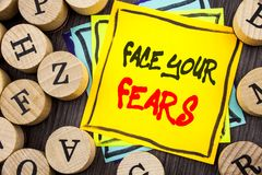 Handwriting Announcement text showing Face Your Fears. Business photo showcasing Challenge Fear Fourage Confidence Brave Bravery w. Ritten wooden abckground with royalty free stock photography