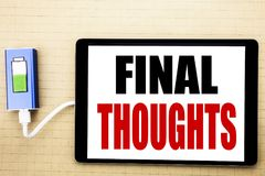 Handwriting Announcement text showing Final Thoughts. Business concept for Conclusion Summary Text Written on tablet with white ba. Ckground charger power bank Stock Images