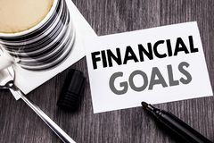 Handwriting Announcement text showing Financial Goals. Business concept for Income Money Plan written on sticky note paper on the. Handwriting Announcement text Royalty Free Stock Photo