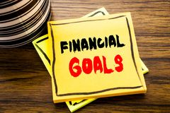 Handwriting Announcement text showing Financial Goals. Business concept for Income Money Plan written on sticky note paper on the. Handwriting Announcement text Royalty Free Stock Images