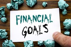 Handwriting Announcement text showing Financial Goals. Business concept for Income Money Plan Written on sticky note paper, wooden. Background folded yellow Royalty Free Stock Images