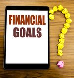 Handwriting Announcement text showing Financial Goals. Business concept for Income Money Plan Written on tablet with wooden backgr. Handwriting Announcement text Stock Images