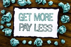 Handwriting Announcement text showing Get More Pay Less. Business concept for Budget Slogan Concept Written on sticky note paper,. Wooden background folded blue Royalty Free Stock Photos