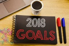 Handwriting Announcement text showing 2018 Goals. Business concept for financial planning, business strategy written on notebook b stock image