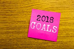 Handwriting Announcement text showing 2018 Goals. Business concept for financial planning, business strategy written on sticky not stock photo