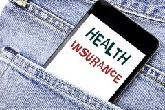 Handwriting Announcement text showing Health Insurance. Business concept for Medical Healthcare Written phone mobile phone, cellph. One placed in man front jeans Stock Photography