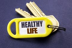 Handwriting Announcement text showing Healthy Life. Business concept for Good Health Food Written on key holder note black backgro. Handwriting Announcement text Stock Photos