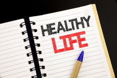 Handwriting Announcement text showing Healthy Life. Business concept for Good Health Food written on notepad with copy space on ol. Handwriting Announcement text stock images