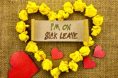 Handwriting Announcement text showing I m am On Sick Leave. Concept meaning Vacation Holiday Absent Out Of Office Sickness Fever w. Ritten Sticky Note Paper With Stock Photo