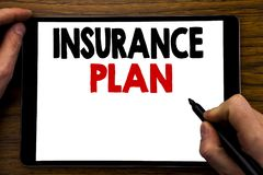 Handwriting Announcement text showing Insurance Plan. Business concept for Health Life Insured Written on tablet laptop, wooden ba. Handwriting Announcement text Royalty Free Stock Images
