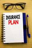 Handwriting Announcement text showing Insurance Plan. Business concept for Health Life Insured Written on tablet laptop, wooden ba. Handwriting Announcement text Royalty Free Stock Photography