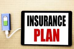 Handwriting Announcement text showing Insurance Plan. Business concept for Health Life Insured Written on tablet with white backgr. Ound charger power bank Stock Photos