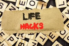 Handwriting Announcement text showing Life Hacks. Concept meaning Solution Hacking Hack Trick To Help Efficiency written on tear p. Handwriting Announcement text Royalty Free Stock Images