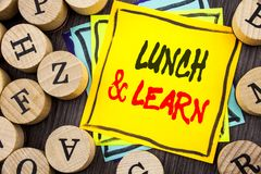 Handwriting Announcement text showing Lunch And Learn. Business photo showcasing Presentation Training Board Course written on woo. Handwriting Announcement text Stock Photos
