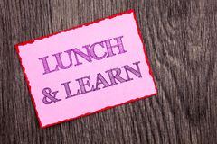 Handwriting Announcement text showing Lunch And Learn. Conceptual photo Presentation Training Board Course written on Pink Sticky. Handwriting Announcement text Stock Photo