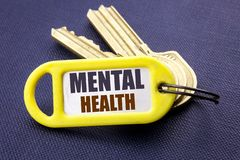 Handwriting Announcement text showing Mental Health. Business concept for Anxiety Illness Disorder Written on key holder note blac. Handwriting Announcement text stock photography