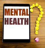 Handwriting Announcement text showing Mental Health. Business concept for Anxiety Illness Disorder Written on tablet with wooden b. Handwriting Announcement text royalty free stock photos
