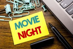 Handwriting Announcement text showing Movie Night. Business concept for Wathing Movies written on sticky note paper on the wooden. Handwriting Announcement text stock photography