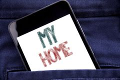 Handwriting Announcement text showing My Home. Business concept for House Estate Love Written phone mobile phone, cellphone placed. In man front jeans pocket stock photography