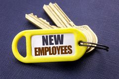 Handwriting Announcement text showing New Employees. Business concept for Welcome Staf Recruiting Written on key holder note black. Handwriting Announcement text Royalty Free Stock Photo