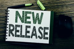 Handwriting Announcement text showing New Release . Business concept for Technology Software Update written on notebook book note. Paper on wooden background stock image