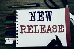 Handwriting Announcement text showing New Release . Business concept for Technology Software Update Written on notebook, wooden ba. Ckground office equipment royalty free stock image