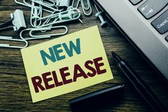 Handwriting Announcement text showing New Release . Business concept for Technology Software Update written on sticky note paper o. N wooden background next to royalty free stock photo